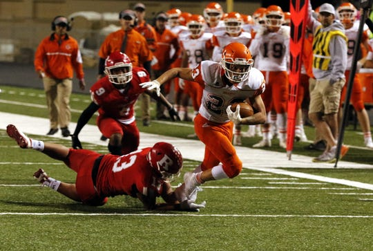 Artesia's Johntae breaks a tackle against Roswell on Oct. 18, 2019. Roswell won, 48-28.