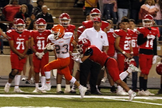 Artesia's Johntae Rodriguez breaks a tackle while returning a punt in the first half of Friday's game against Roswell. Roswell won, 48-28.