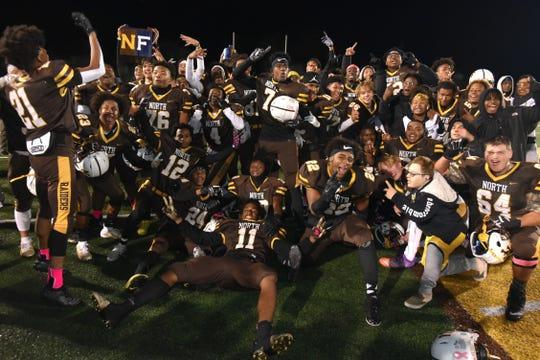 The North Farmington Raiders celebrate their 13-9 victory over Farmington on Oct. 17, 2019.