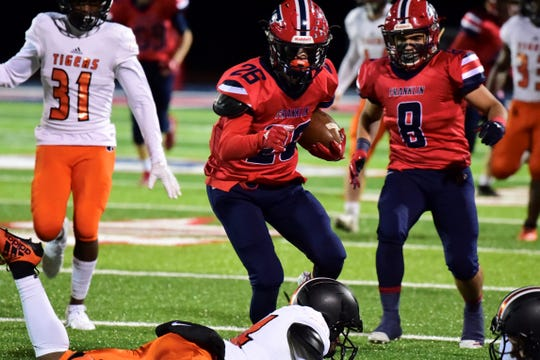 Livonia Franklin's Connor Hatfield races up the field on a kick return against Belleville.