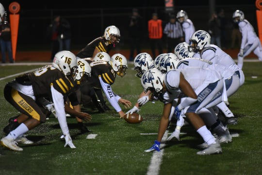 The North Farmington High Raiders, left, goes up against the Farmington Falcons on Oct. 17, 2019.