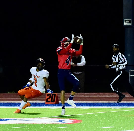 Livonia Franklin's Dom Ufferman secures an interception against Belleville.