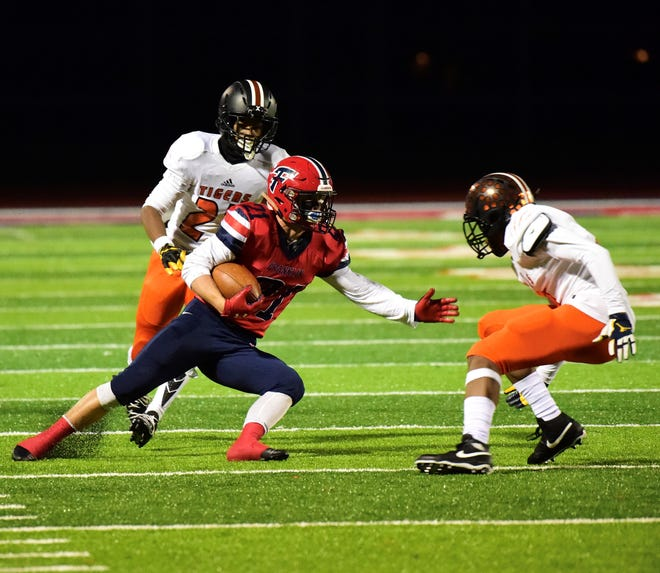 Livonia Franklin's Grant Gibson makes a move against Belleville.