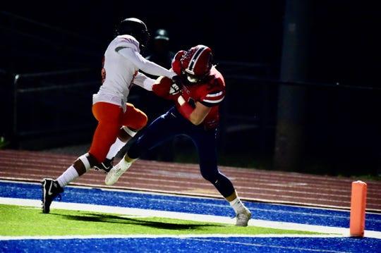 Livonia Franklin's Evan Pittenger secures a touchdown catch against Belleville.