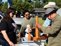 Demonstrating an okra cutter at the SARDI and Agromen Community Fall Fest Saturday in Opelousas.
