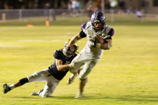 Jaden Donovan of Shadow Hills tries to get extra yardage with a Xavier Prep defender hanging on during the Knights' final drive.  Xavier Prep held on to win 7-6.