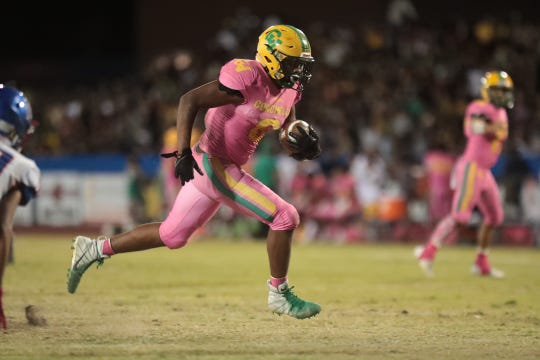 Coachella Valley's Josh Moore runs the ball during the Victory Bell game against Indio High in Indio, Calif., on Friday, October 19, 2019.