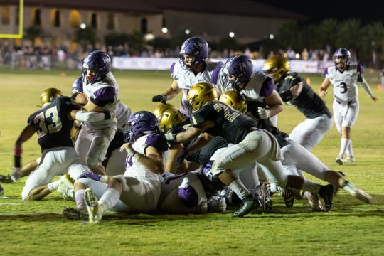 The Xavier Prep defense comes up with a big stop against Shadow Hills in thje final minute  in high school football Oct. 18, 2019.