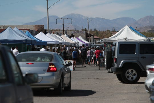 People in vehicles wait for a parking spot at the Joshua Tree Certified Farmers' Market in Joshua Tree, Calif., on Saturday, October 19, 2019.