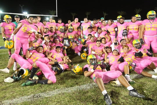 Coachella Valley poses for a photograph with the Victory Bell after winning the game against Indio in Indio, Calif., on Friday, October 19, 2019.