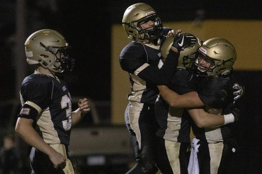 Delone Catholic celebrates after defeating York Catholic 23-7 in football at Delone Catholic High School in McSherrystown, Friday, October 18, 2019.