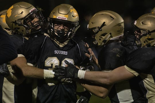 Delone Catholic's Ryan Myers, second from left, celebrates with his teammates after catching a touchdown pass. Delone Catholic defeats York Catholic 23-7 in football at Delone Catholic High School in McSherrystown, Friday, October 18, 2019.