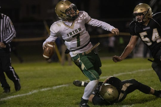 York Catholic quarterback Mitchell Galentine, left, is sacked by Delone Catholic defenders, Tate Neiderer, bottom center, and, Nick Groft, right. Delone Catholic defeats York Catholic 23-7 in football at Delone Catholic High School in McSherrystown, Friday, October 18, 2019.