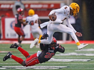 Utah linebacker Devin Lloyd (20) tackles Arizona State quarterback Jayden Daniels (5) during the first half of an NCAA college football game Saturday, Oct. 19, 2019, in Salt Lake City.