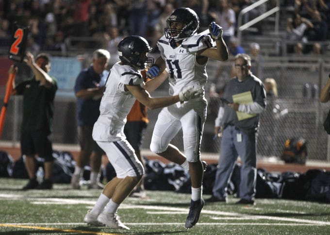 Higley's Isaiah Eastman (11) and Truitt Robinson (4) celebrate their touchdown against Campo Verde during the first half of their game in Gilbert, Friday, Oct. 18, 2019.