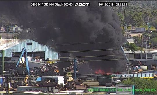 Large scrapyard fire in downtown Phoenix contained; smoke seen for miles