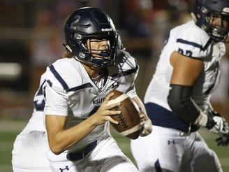 Higley's Kai Millner (2) looks to pass against Camp Verde during the first half of their game in Gilbert, Friday, Oct. 18, 2019.