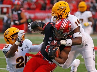 Utah running back Zack Moss (2) is tackled by Arizona State safety Aashari Crosswell (16) during the first half of an NCAA college football game Saturday, Oct. 19, 2019, in Salt Lake City.