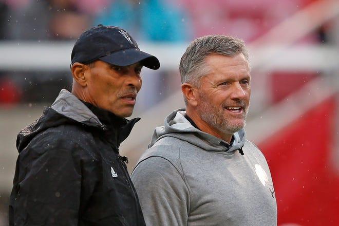 Arizona State head coach Herm Edwards, left, and Utah head coach Kyle Whittingham speak before an NCAA college football game Saturday, Oct. 19, 2019, in Salt Lake City.