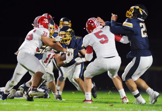 Elco's Erik Williams (7) goes up the middle on this second quarter run  in a game between the Annville-Cleona Dutchmen and the Elco Raiders on Friday Oct.18,2019 at Elco's stadium.