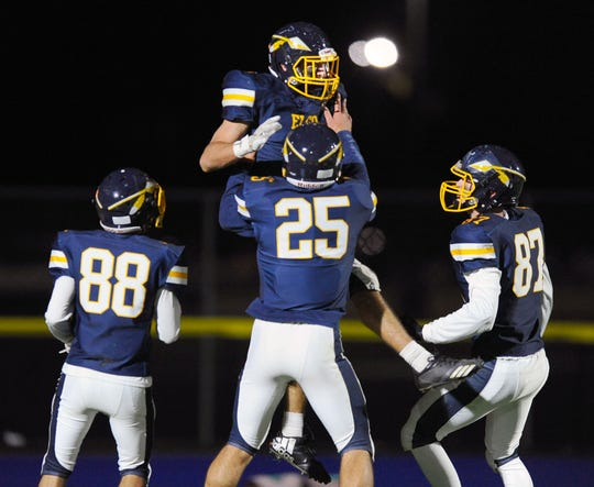 Elco's Erik Williams (7) is lifted in the air by his teammates after scoring Elco's first touchdown of the game  in a game between the Annville-Cleona Dutchmen and the Elco Raiders on Friday Oct.18,2019 at Elco's stadium.