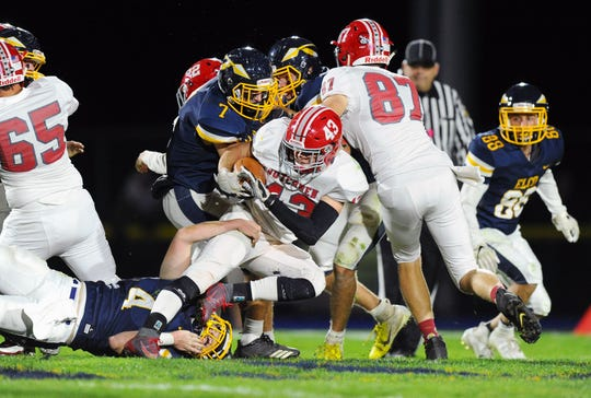 A-C's Trevor Porche (43) is tripped up by Elco's Cole Thomas (4) during second quarter action  in a game between the Annville-Cleona Dutchmen and the Elco Raiders on Friday Oct.18,2019 at Elco's stadium.