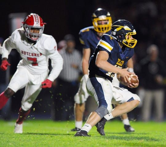Elco's quarterback Braden Bohannon (15) looks for room to run during first quarter action in  a game between the Annville-Cleona Dutchmen and the Elco Raiders on Friday Oct.18,2019 at Elco's stadium.