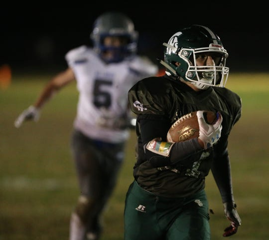 Spackenkill's Dominick Guarnieri carries the ball for a gain during Friday's game versus Millbrook on October 18, 2019.