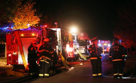 East Fishkill firefighters work at the scene of an early morning 2-alarm fire that destroyed a house at 110 Devon Farms Road on Stormville Mountain in East Fishkill  Oct. 19, 2019.