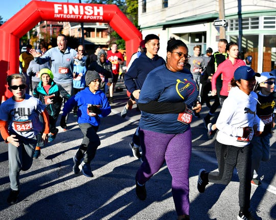 Athletes begin the 3rd annual CommUNITY & Cops 5k at Logos Academy in York City, Saturday, Oct. 19, 2019. Proceeds from the event would benefit Logos Academy as well as fund a scholarship created in memory of former York City Police Chief Wayne Ruppert. Dawn J. Sagert photo