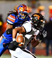 York High defensive end Maurice Feazell, left, is a Class 5-A second-team all-state pick by the Pennsylvania coaches.