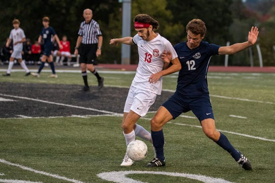 Susquehannock's Nolan Holloway (13) goes up against Dallastown's Mitchell Groh (12) during the YAIAA Boys Soccer final between Dallastown and Susquehannock, Saturday, Oct. 19, 2019, at Northeastern High School. The Dallastown Wildcats won 1-0 over the Susquehannock Warriors.