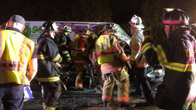 Rescue crews work to extract an injured passenger from a U-Haul van involved in a three-vehicle crash in York County on Thursday, Oct. 17, 2019.