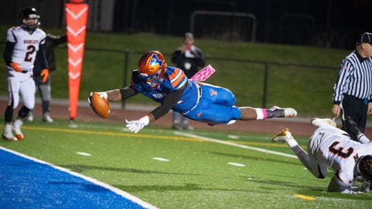 Tyrell Whitt leaps into the end zone during the YAIAA football game between York High and Northeastern at Small Athletic Field on Oct. 18. The Bearcats defeated the Bobcats 32-7.