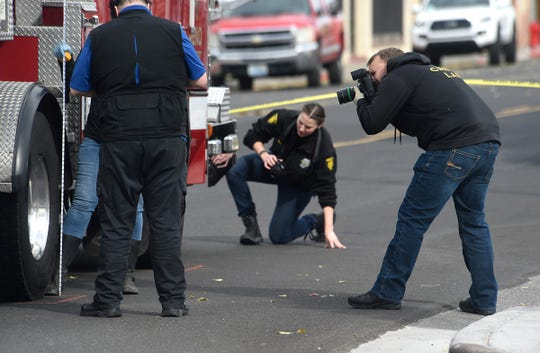 Police investigators respond to a pedestrian fatality on 4th Street in downtown Reno on Oct. 19, 2019. The pedestrian was hit by a Reno Fire Dept. fire truck.