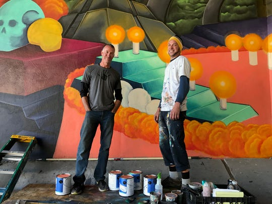 Kyle Isacksen and Asa Kennedy are working on one of the projects that received a portion of the 'Art Belongs Here' grant.