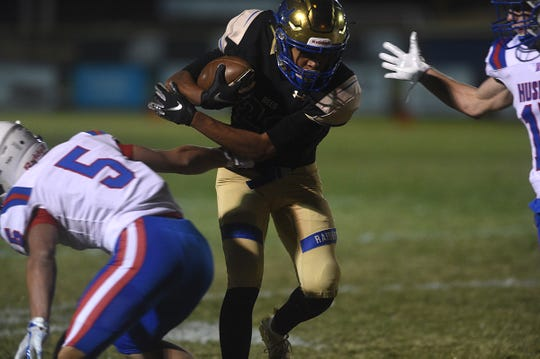 Reed's Raul Lopez runs while taking on Reno during their football game in Sparks on Oct. 18, 2019.