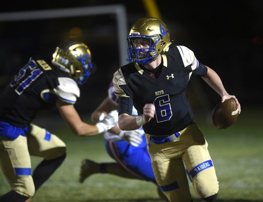 Reed's Jack Franz runs while taking on Reno during their football game in Sparks on Oct. 18, 2019.