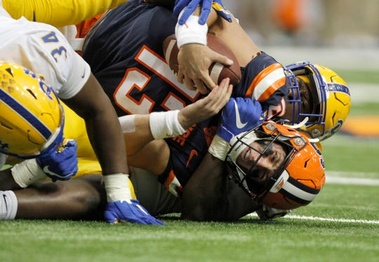 Syracuse's Tommy DeVito, bottom, is sacked by Pittsburgh's Deslin Alexandre during the third quarter of an NCAA college football game in Syracuse on Friday night.