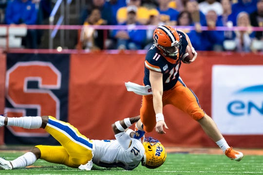 Syracuse quarterback Clayton Welch is tripped up and brought down by Paris Ford of the Pittsburgh Panthers during the third quarter at the Carrier Dome on October 18, 2019 in Syracuse, New York. Pittsburgh defeated Syracuse 27-20.