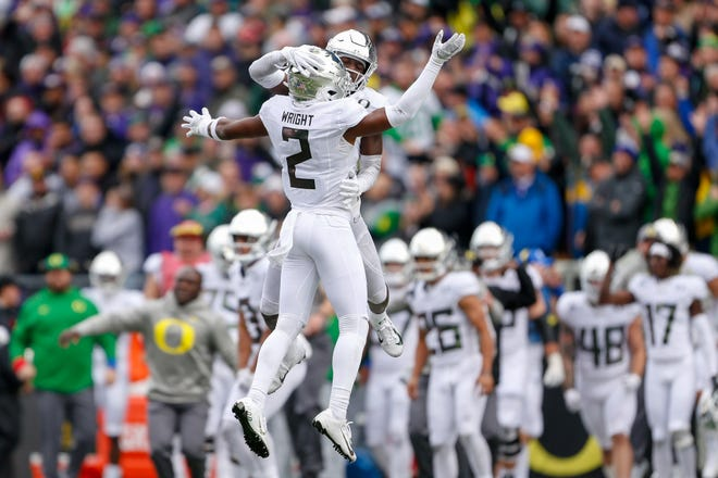 Oregon cornerbacks Mykael Wright (2) and Verone McKinley III celebrate after the Ducks clinched last year's win at Washington with this fourth-down stop.