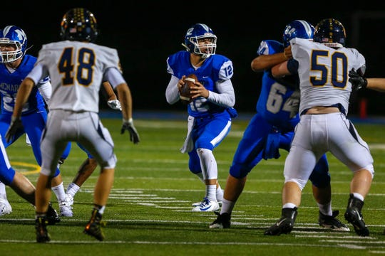 Celtics quarterback Erik Barker (12) looks for a free player during the McNary Celtics and Bend Lava Bears football game at McNary High School, in Salem, Oct. 18, 2019.