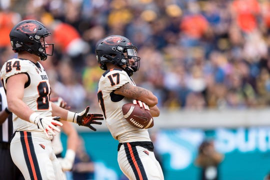 Oregon State wide receiver Isaiah Hodgins (17) reacts with tight end Teagan Quitoriano (84) after scoring a touchdown against the California  in the second quarter of an NCAA college football game in Berkeley, Calif., Saturday, October 19, 2019.