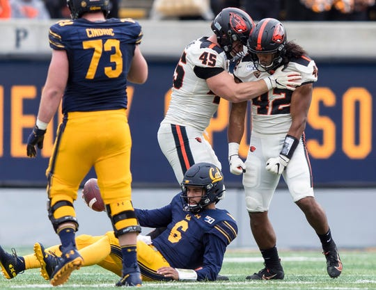 Oregon State defensive lineman Simon Sandberg (45) and teammate Doug Taumoelau (42) react after sacking California quarterback Devon Modster (6) in the second quarter of an NCAA college football game in Berkeley, Calif., Saturday, Oct. 19, 2019.