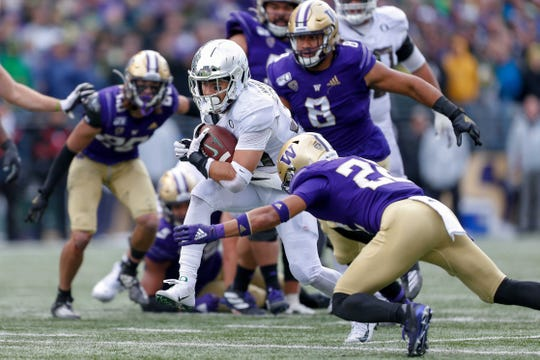 Oct 19, 2019; Seattle, WA, USA; Washington Huskies defensive back Trent McDuffie (22) tackles Oregon Ducks running back Cyrus Habibi-Likio (33) during the second half at Husky Stadium. Mandatory Credit: Jennifer Buchanan-USA TODAY Sports