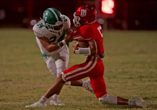 Eldorado High School's Marco Martinez looks to bring down Miles Bulldog Jose Mata during a District 8-2A Division II football game Oct. 18, 2019, at Gary Krejci Memorial Stadium in Miles.