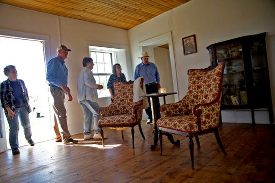 People visit the Tankersley Homestead after a historical marker dedication ceremony Saturday, Oct. 19, 2019.