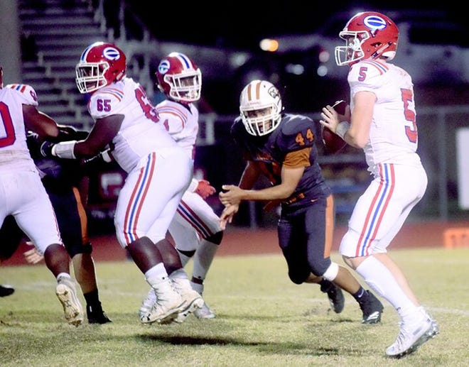 Evangel quarterback Blake Shapen sets up looking for Jiren Rattler in the end zone.