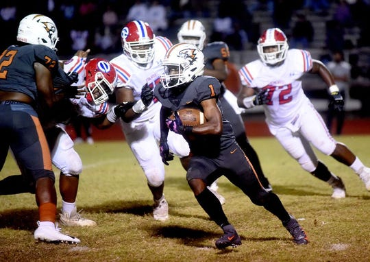 Northwood's Terrence Cooks runs the ball against the Evangel defense Friday in the District 1-4A contest.