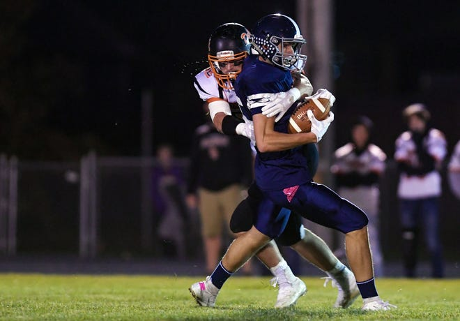 Carter Nelson of Dell Rapids tackles Derek Eidsness of West Central during their football game on Friday, October 18, in Hartford.